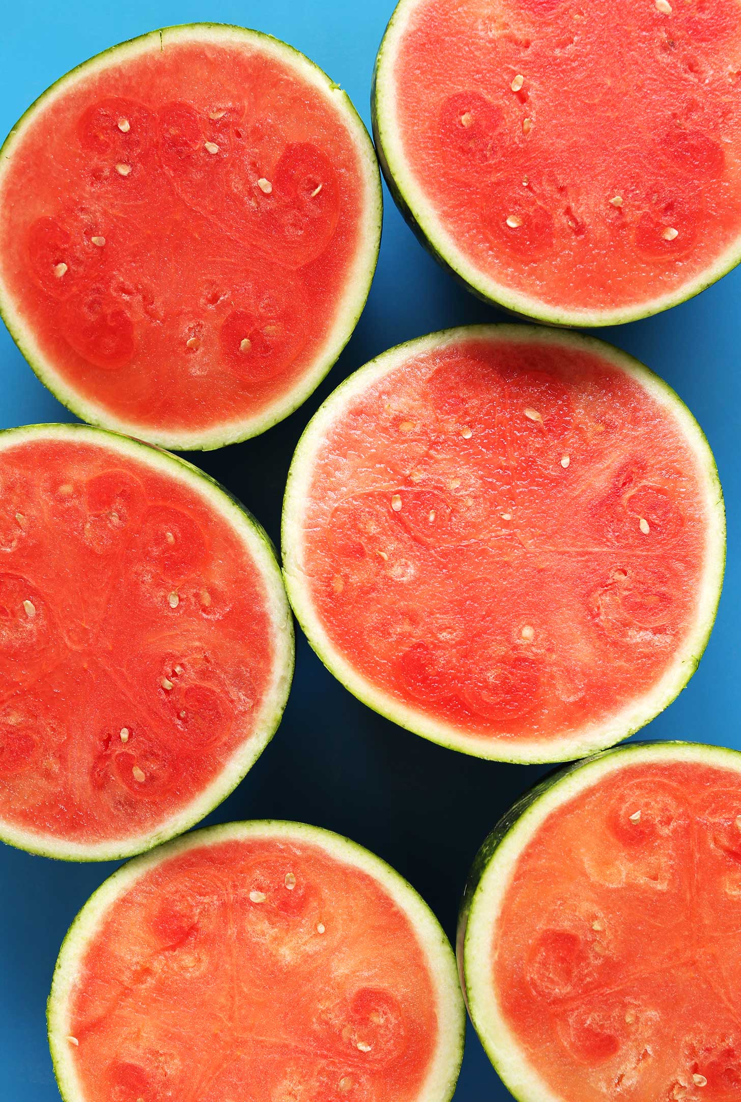 Halved watermelons for making a summer vegan smoothie recipe