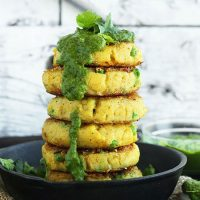Stack of Indian Potato Cakes with Green Chutney dripping down the side