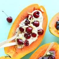 Fresh Papaya Boats loaded with toppings for a healthy summer breakfast