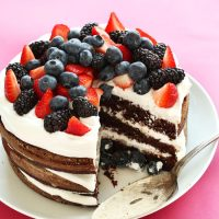 Triple layer Vegan Gluten-Free Chocolate Cake topped with fresh berries