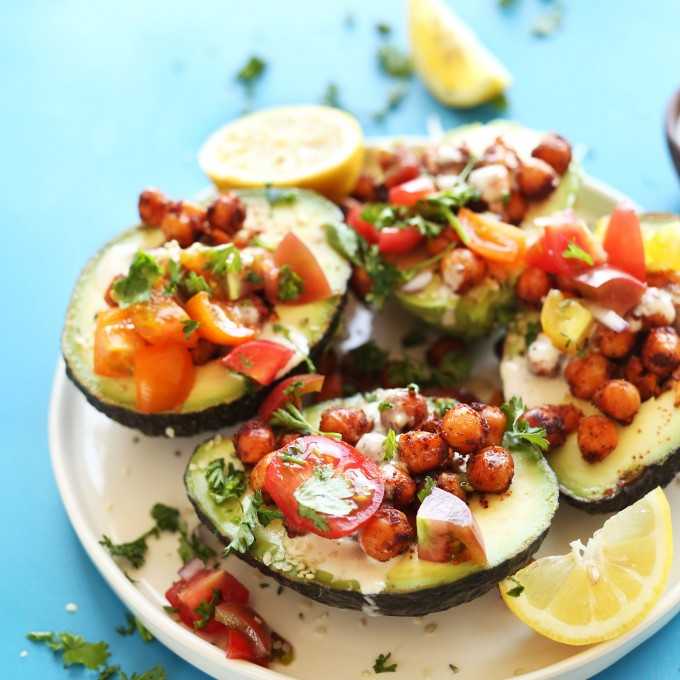 Plate of our Mediterranean-inspired Avocado Boats for a healthy vegan dinner recipe