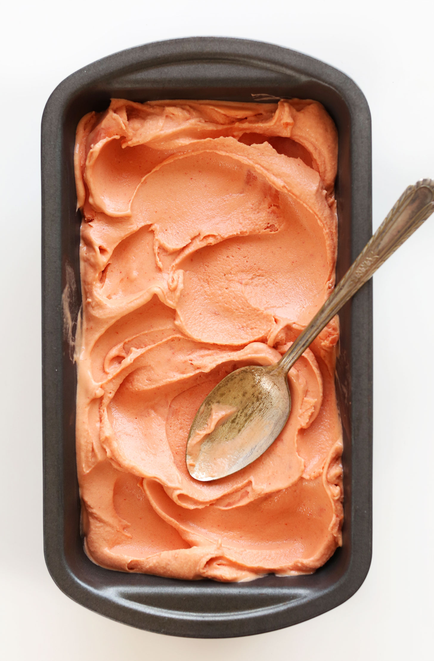 Pan of homemade gluten-free vegan Mango Raspberry Coconut Sorbet