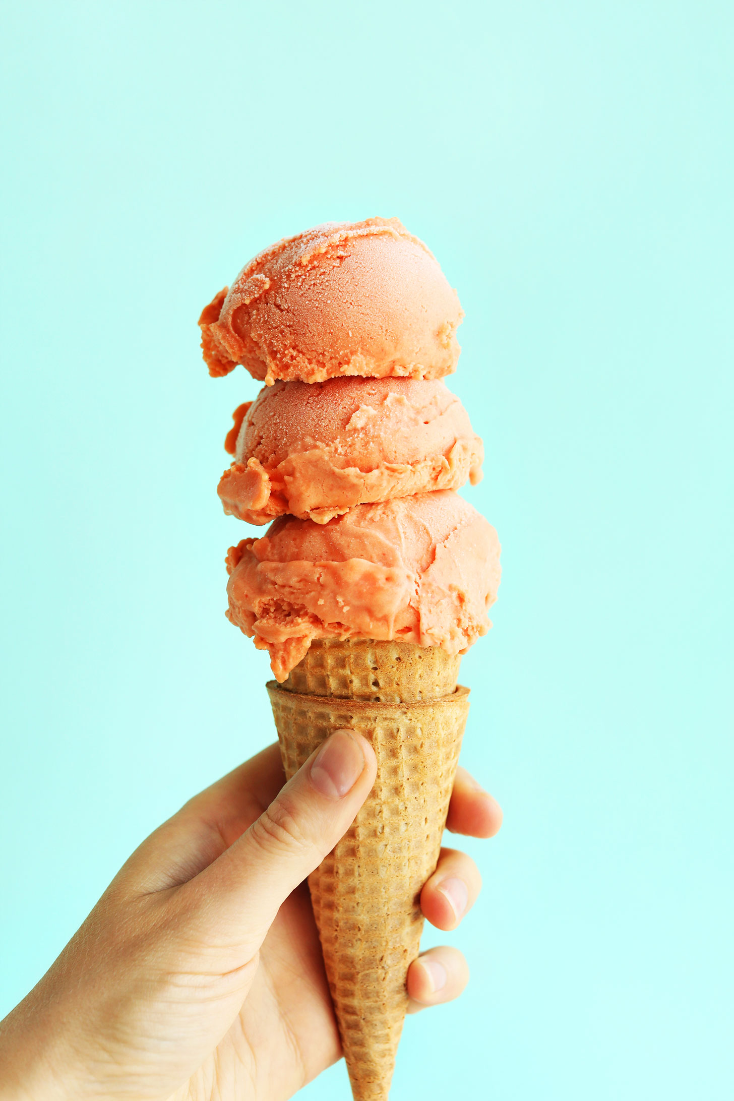 Scoops of our Creamy Mango Raspberry Coconut Sorbet for a delicious summer vegan dessert