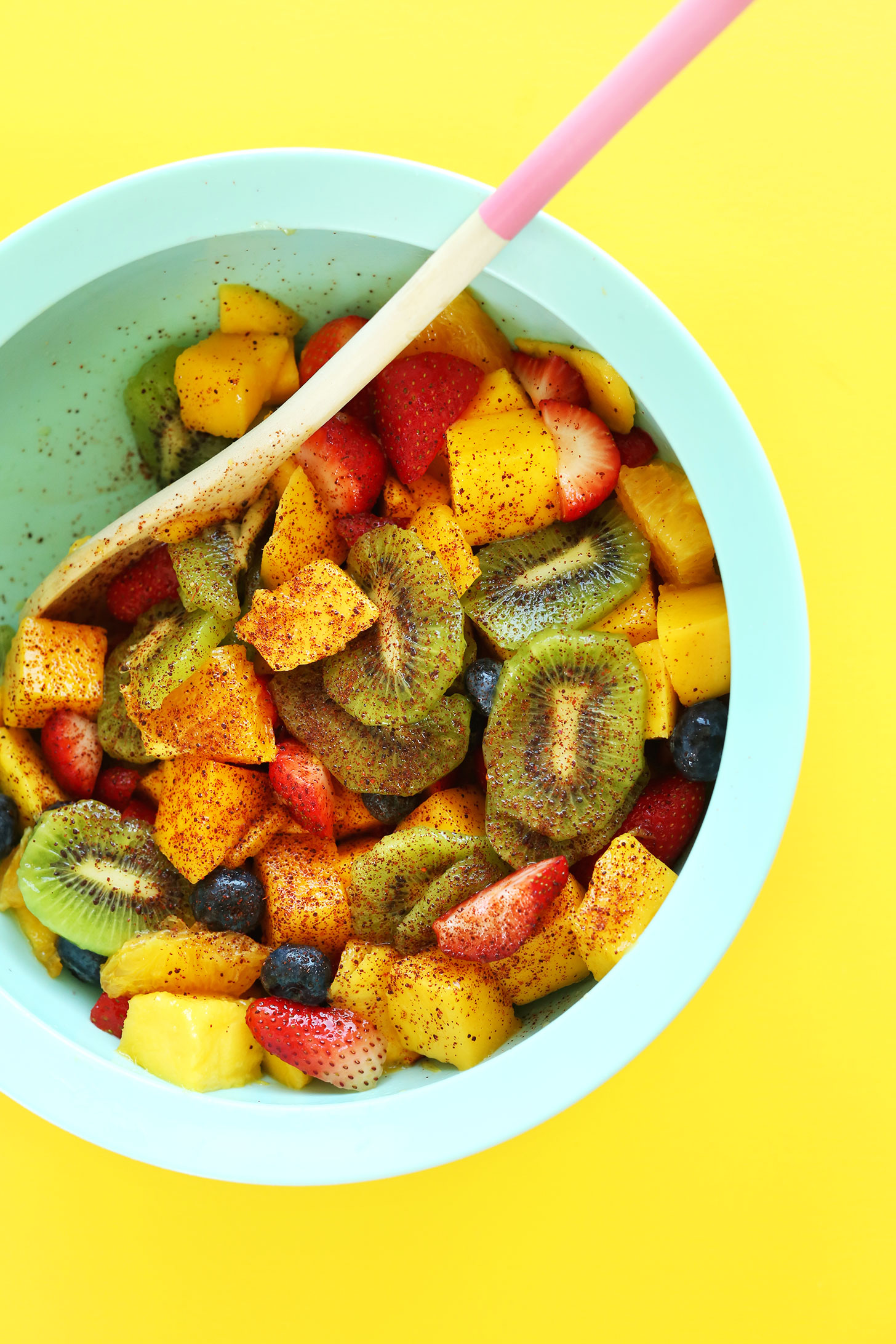 A bowl of our Spicy Fruit Salad sprinkled with chili powder for a kick of heat