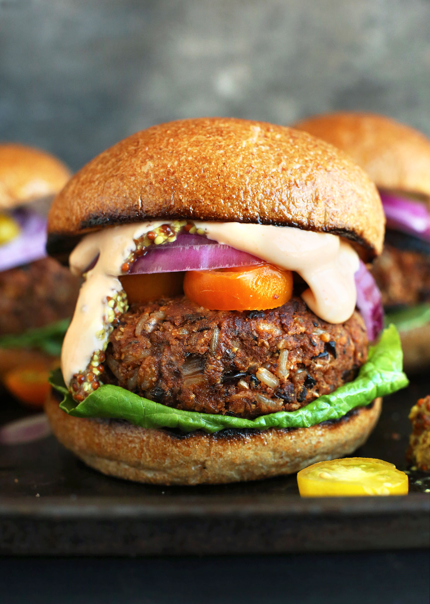 An amazing grillable Veggie Burger patty on a bun with lettuce, tomato, onion and sauce