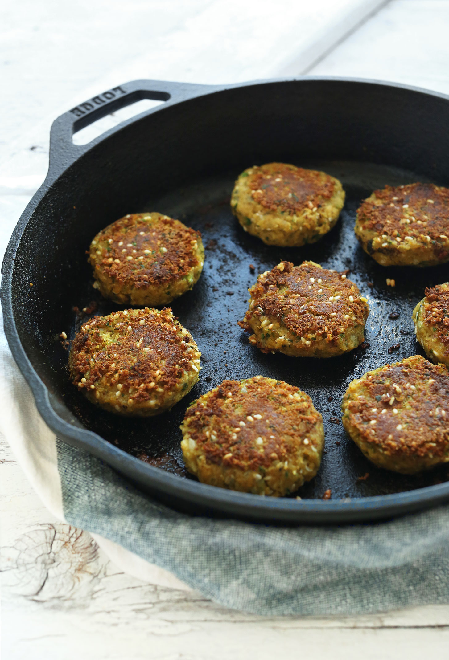 Cooking easy vegan falafel in a cast-iron skillet