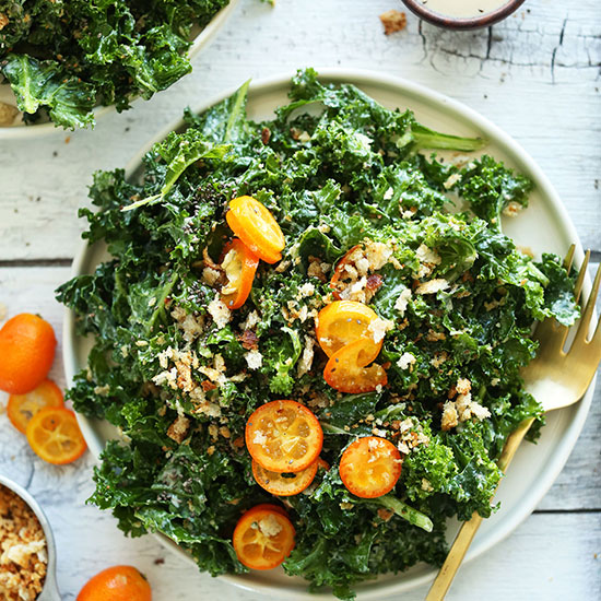 Big plate of Kale Kumquat Salad for a healthy vegan dinner