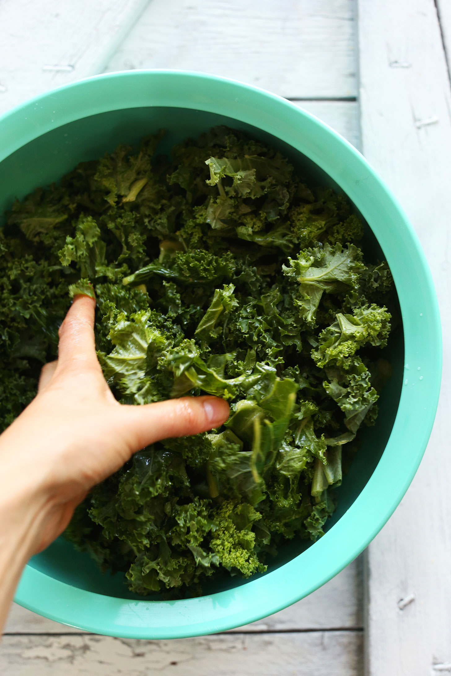 Massaging kale for making a healthy and refreshing vegan salad