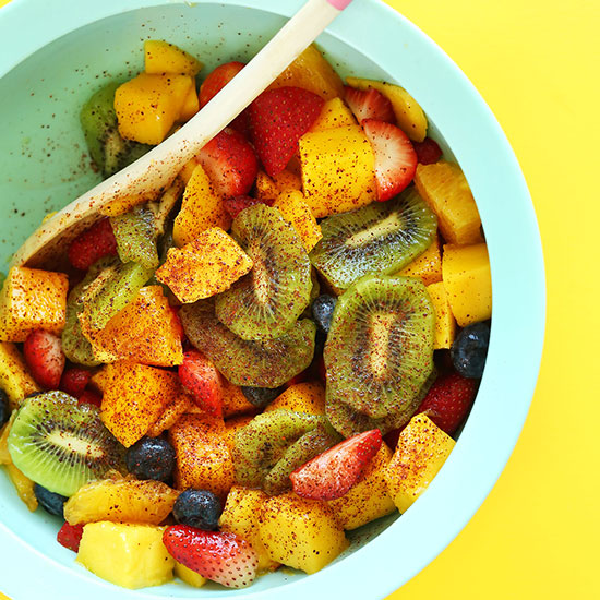 Blue mixing bowl filled with our Spicy Fruit Salad recipe