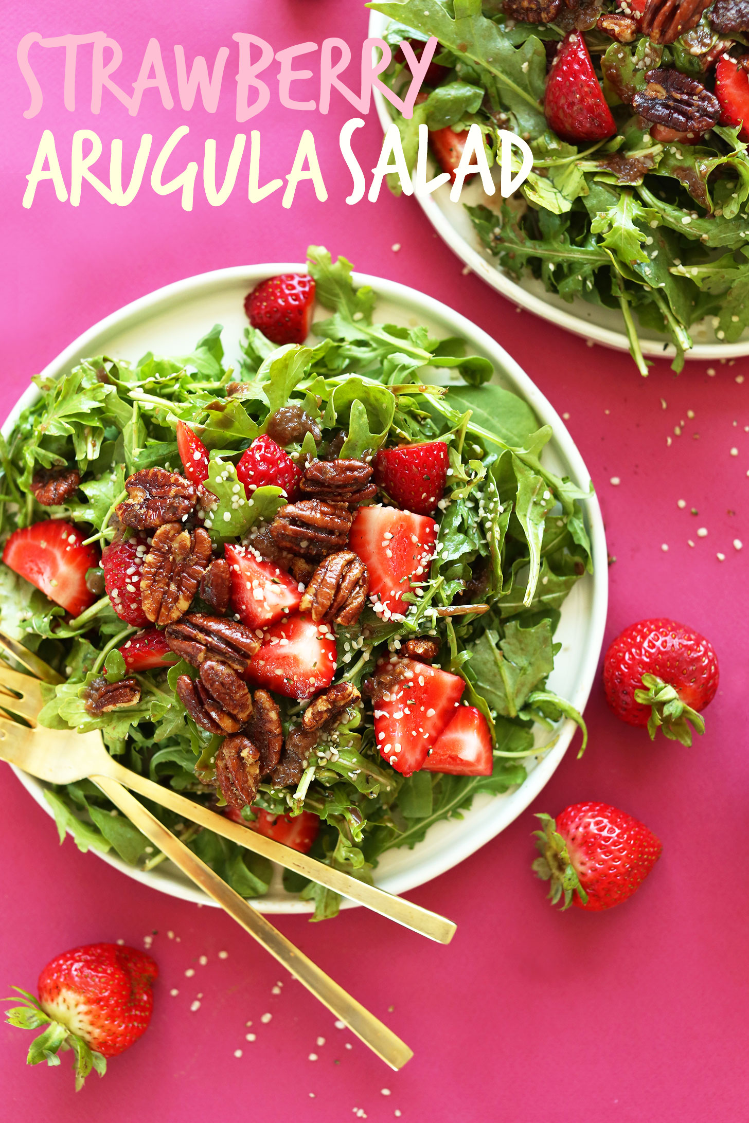 Big plate of vegan Strawberry Arugula Salad with Brown Sugar Pecans and Warm Shallot Vinaigrette