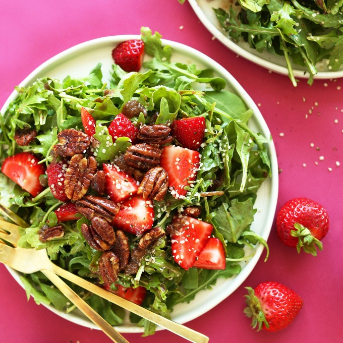 Big plate filled with Strawberry Arugula Salad with Brown Sugar Pecans and a Warm Shallot Vinaigrette