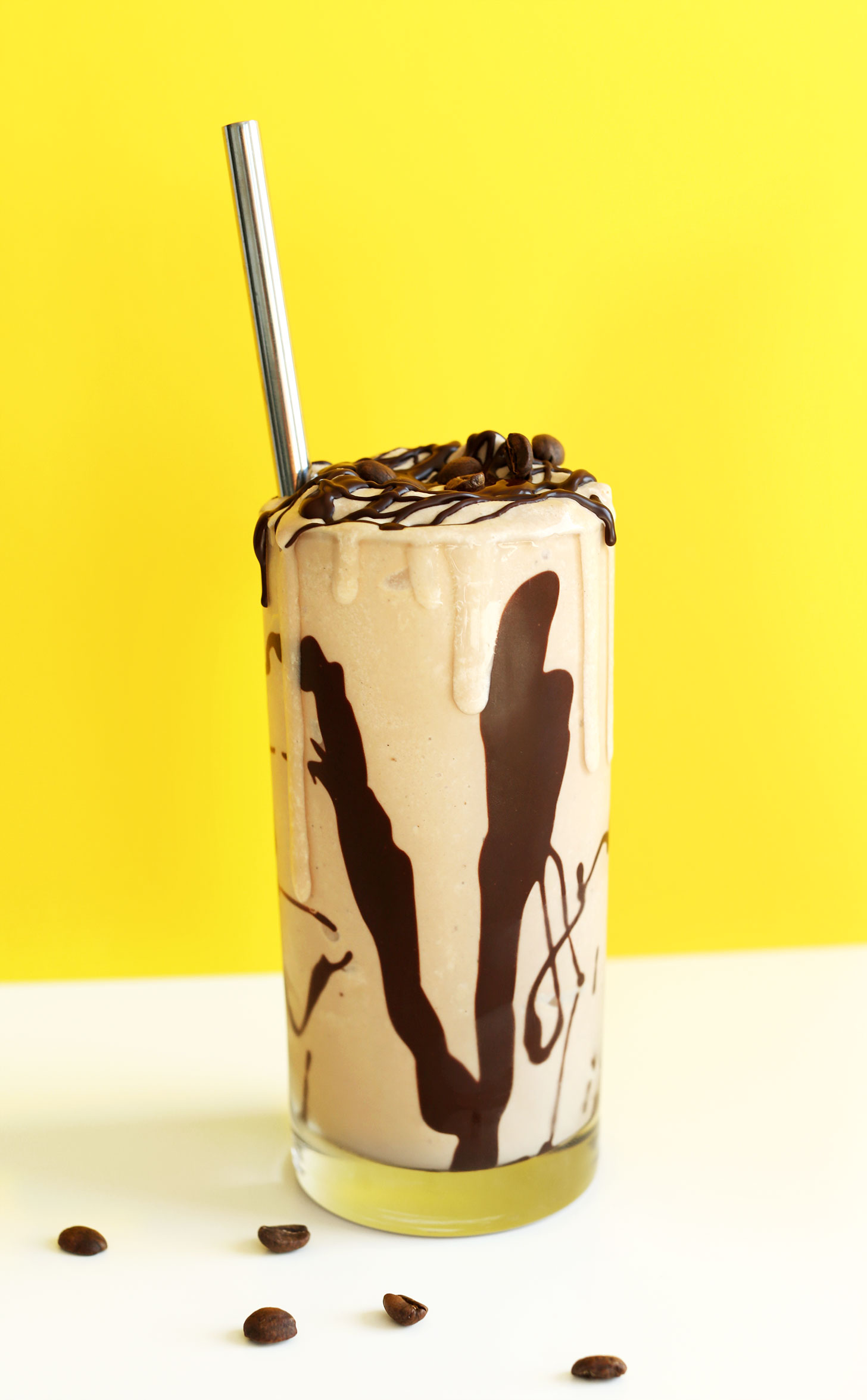 Large glass overflowing with our amazing Vegan Mocha Shake recipe