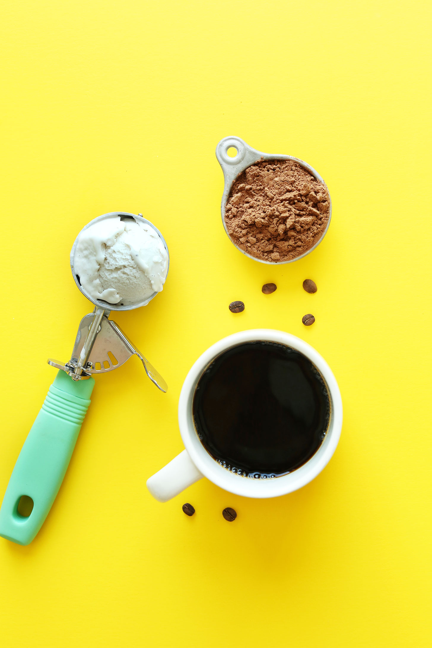 Cocoa powder, vegan ice cream, and coffee for making a delicious vegan milkshake