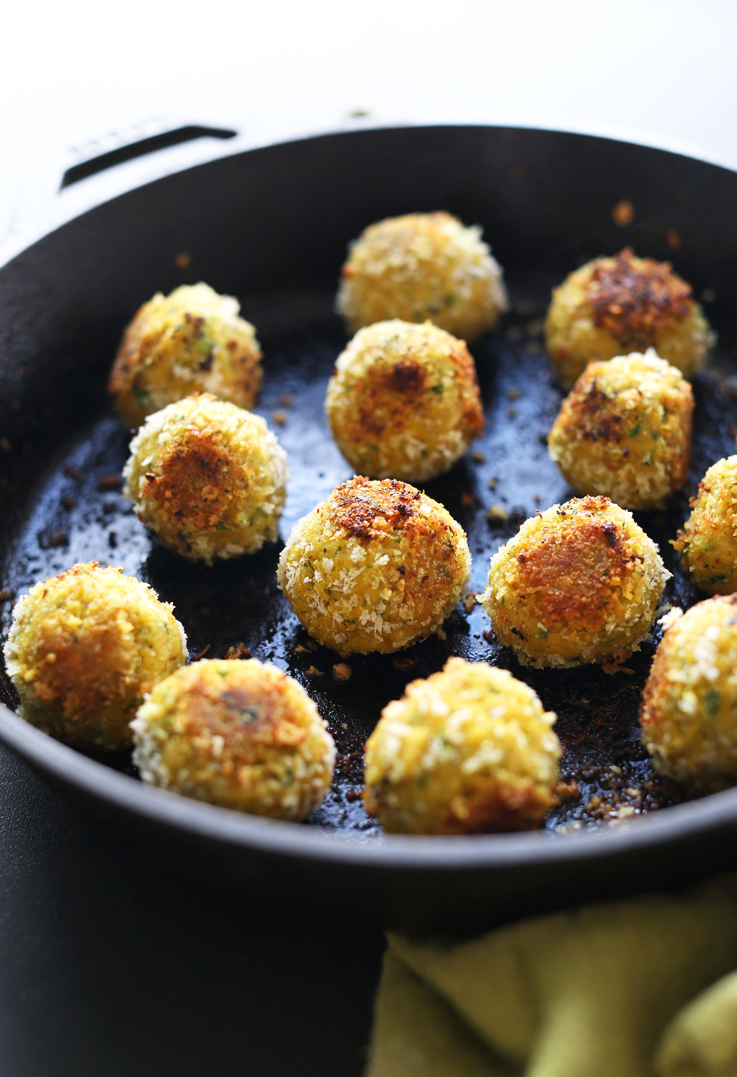 Cast-iron skillet filled with our healthy vegan Turmeric Chickpea Fritters