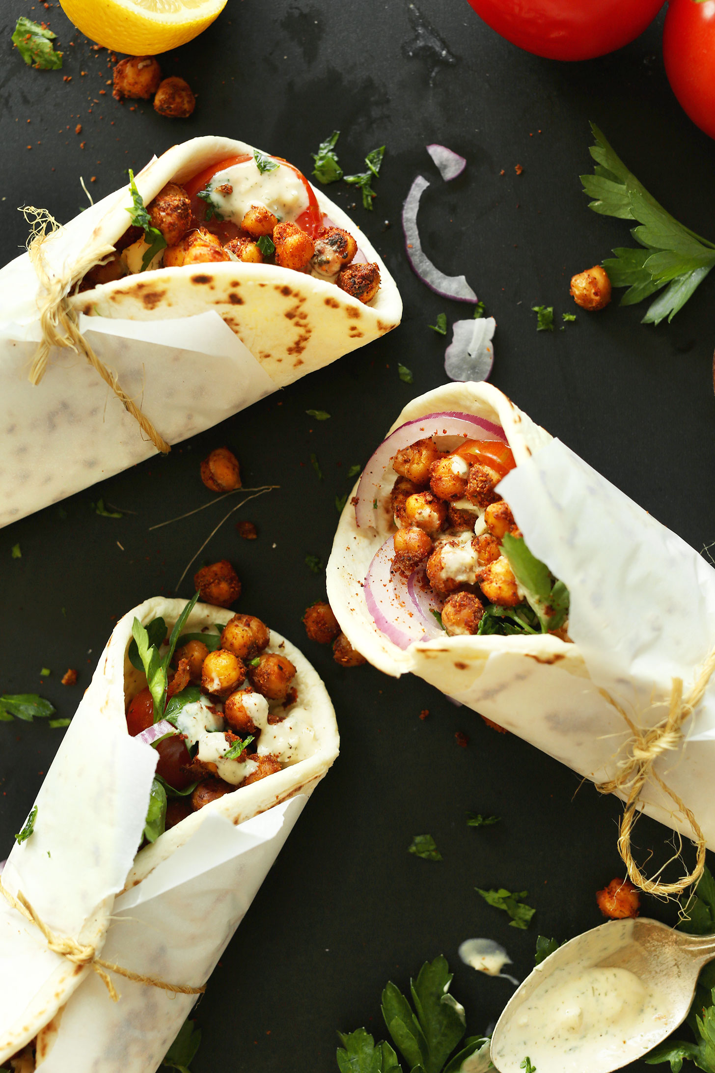 Healthy Chickpea Shawarma Wraps rolled in parchment paper and wrapped with twine