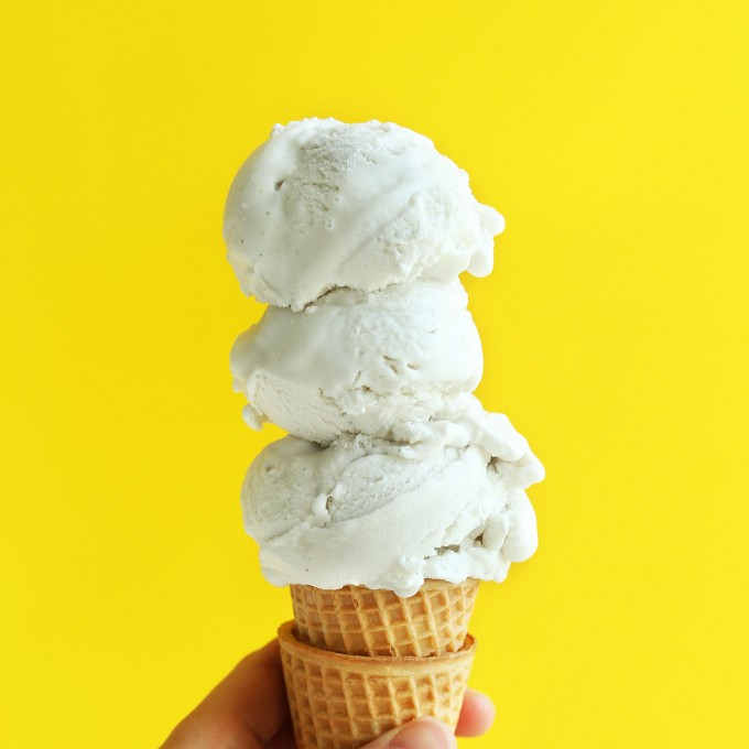 Triple scoop cone of homemade vegan vanilla ice cream