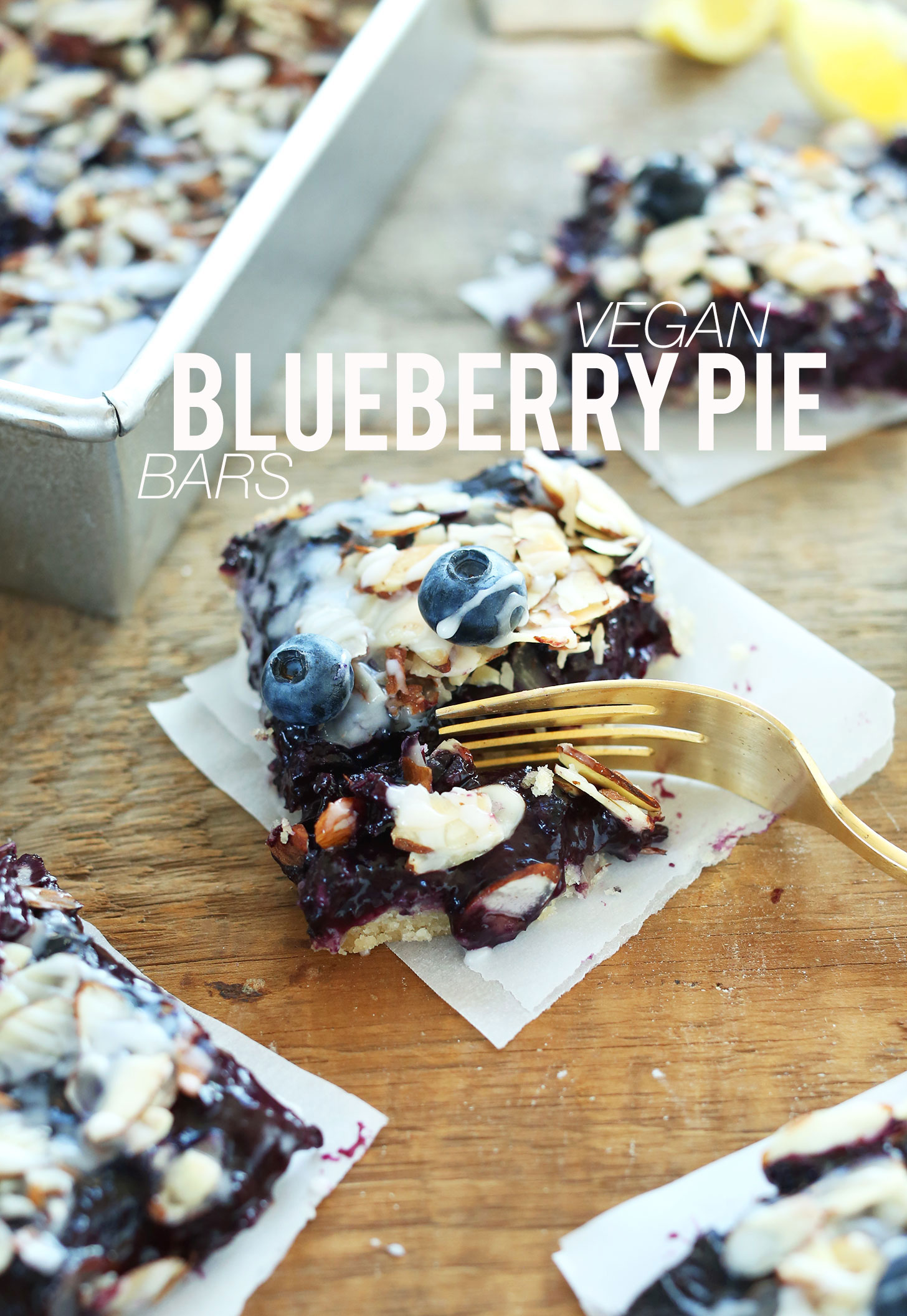 Grabbing a bite of a Vegan Blueberry Pie Bar for a delicious summer dessert