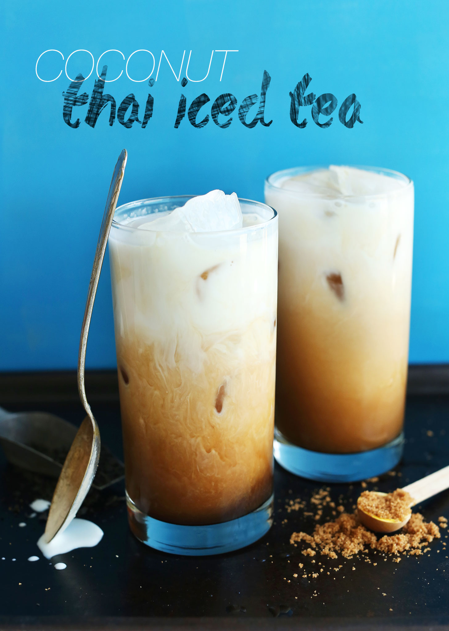 Two glasses of our Coconut Thai Iced Tea made with black tea, vanilla, natural sweeteners, and coconut milk