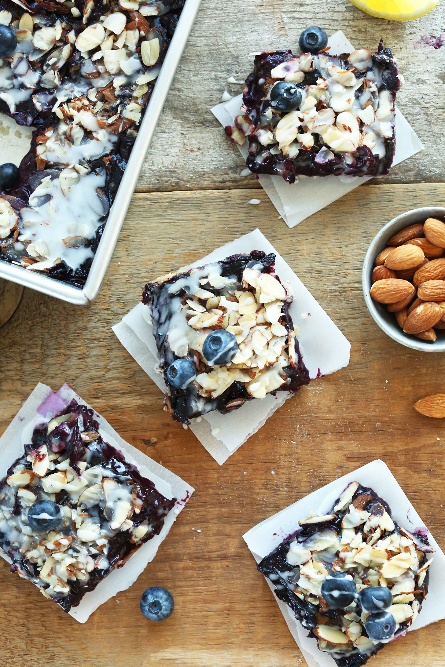 Squares of our Almond Blueberry Pie Bars for a delicious summertime vegan dessert