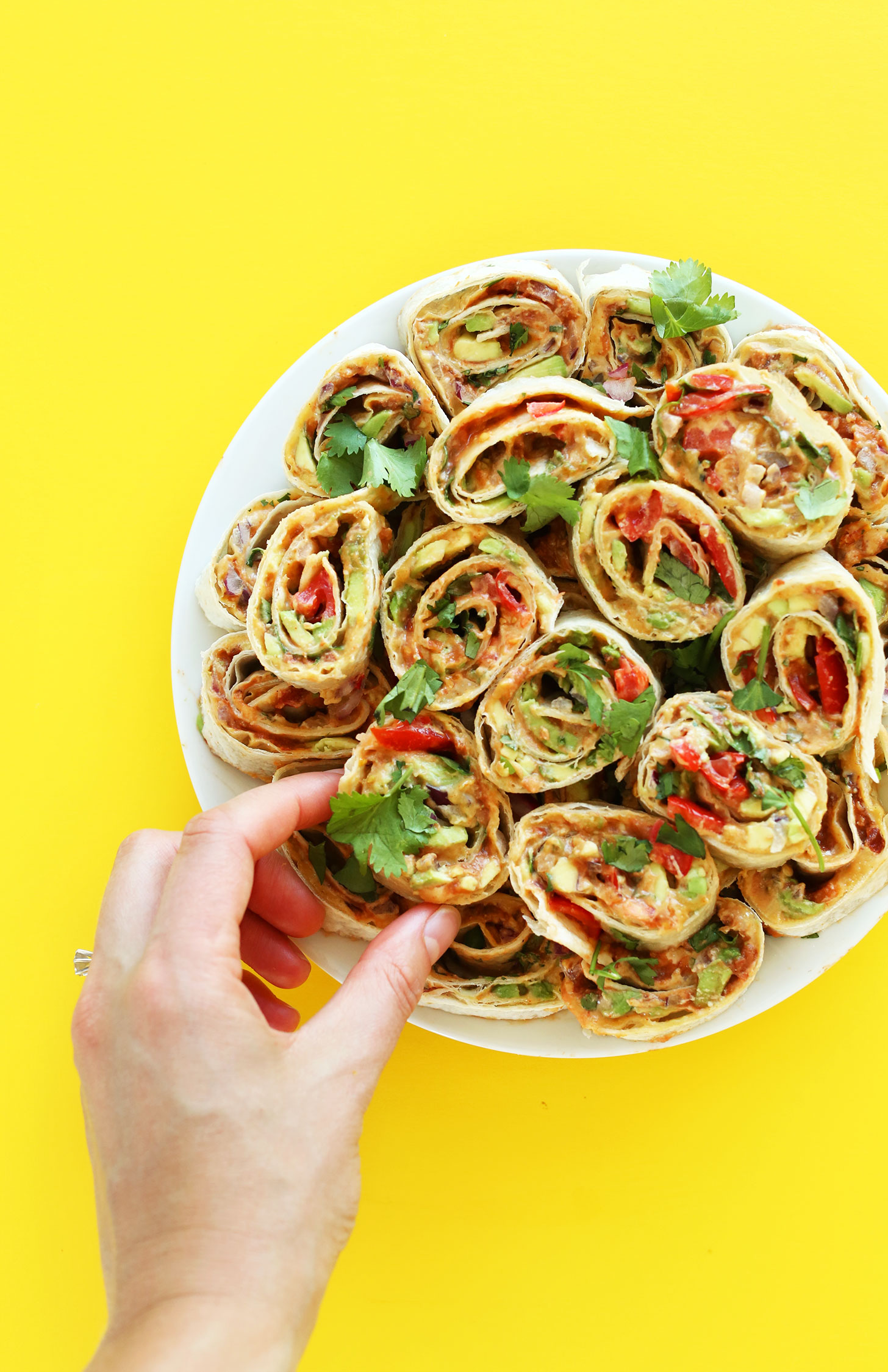 Plate of Mexican Pinwheels for the perfect vegan finger food