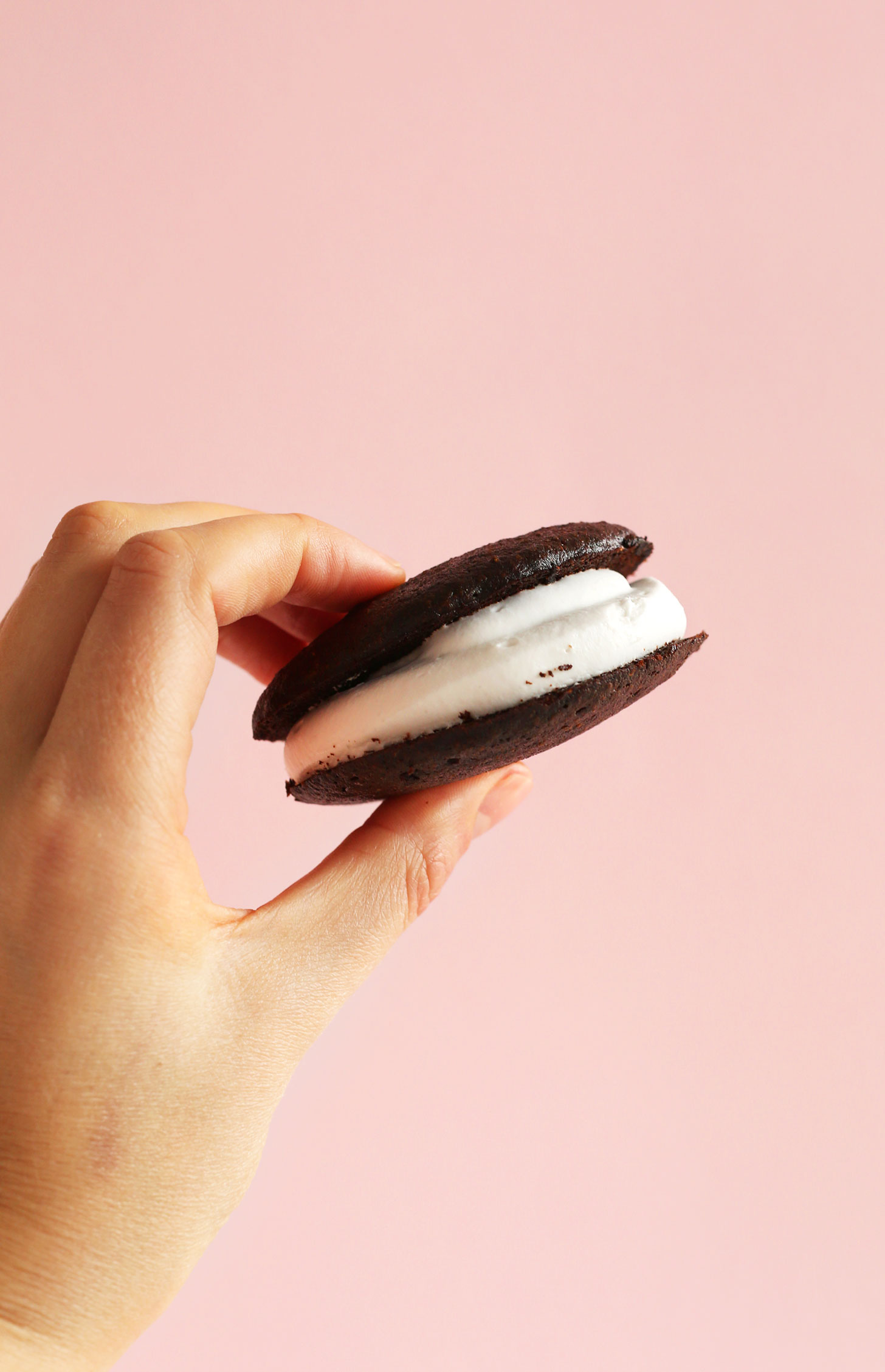 Holding up one of our simple Vegan Whoopie Pies
