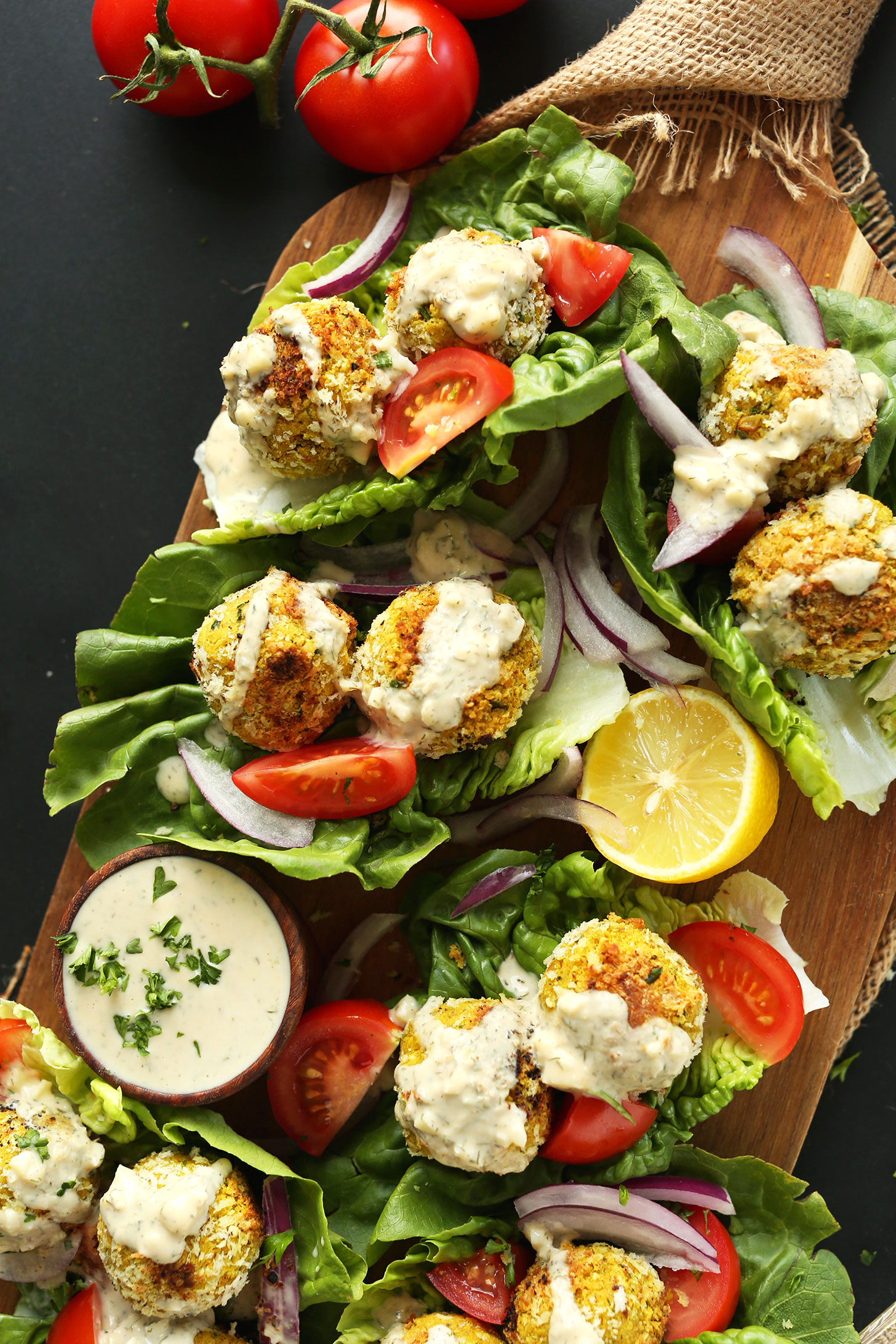 Lettuce wraps filled with our Turmeric Chickpea Fritters recipe and fresh vegetables