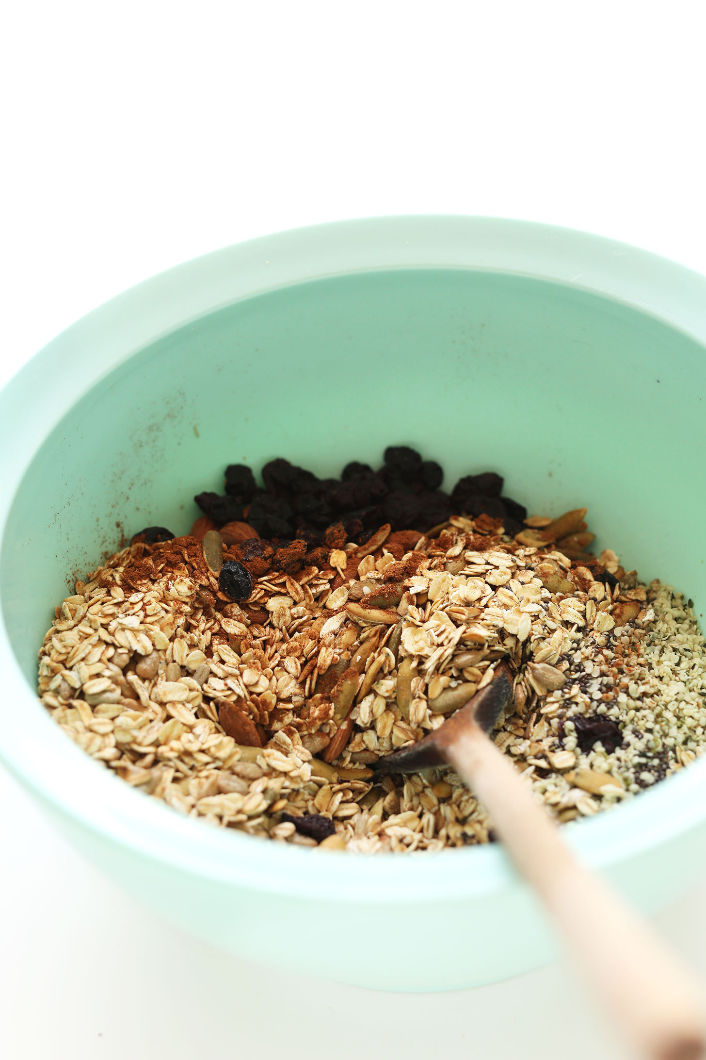 Stirring together ingredients for gluten-free vegan Toasted Pumpkin Muesli