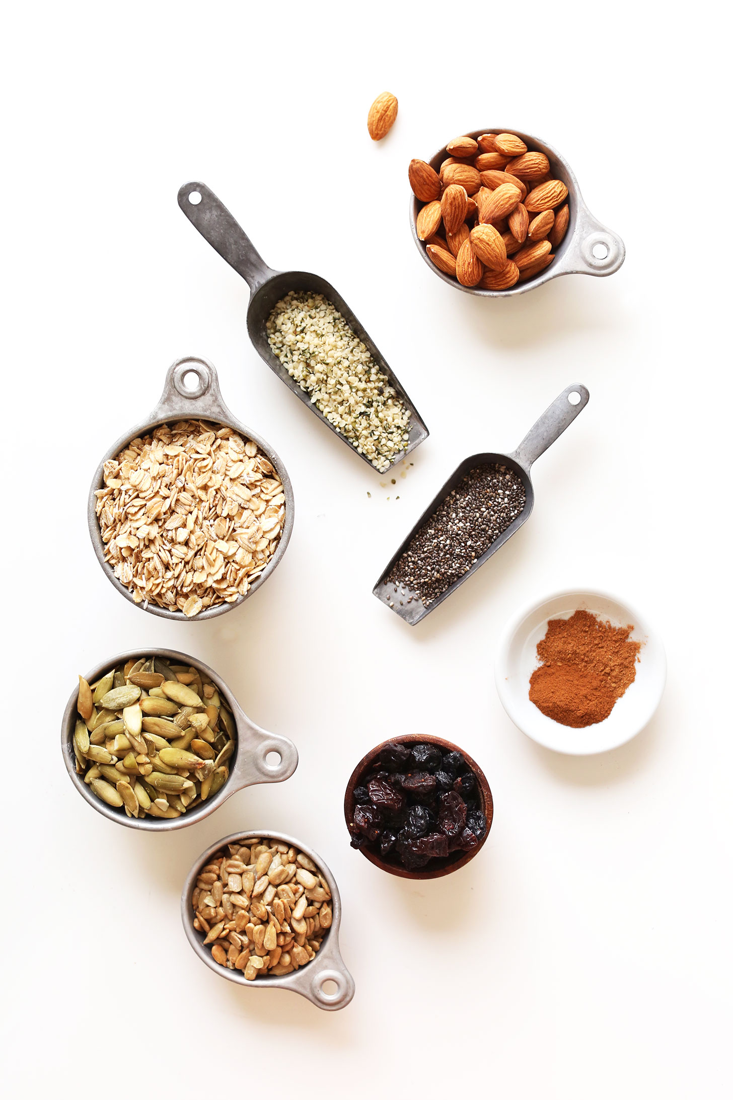 Hemp seeds, chia seeds, almonds, oats, pumpkin seeds, sunflower seeds, dried fruit, and spices for making homemade muesli