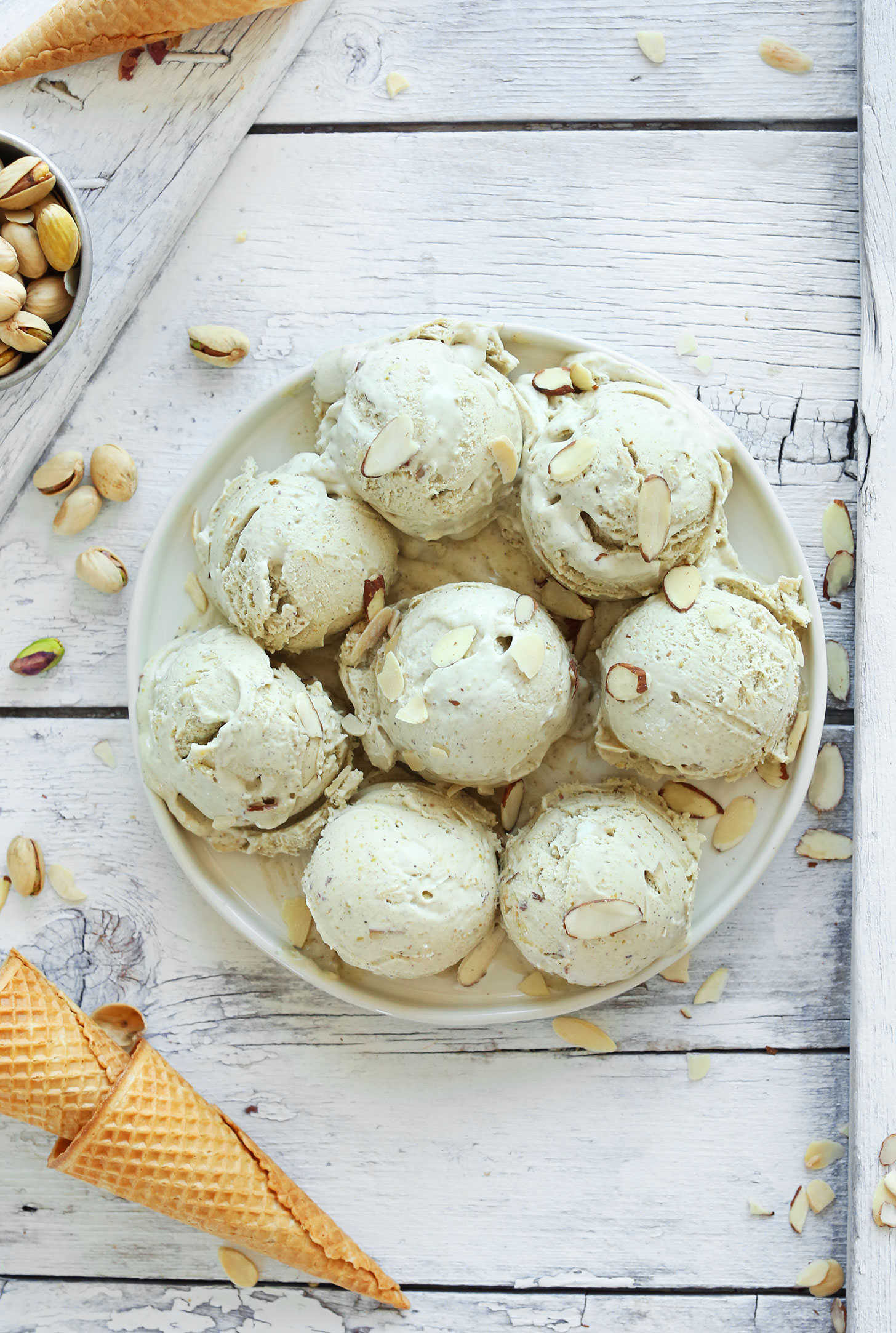 VEGAN PISTACHIO and ALMOND Ice Cream! So rich and creamy, perfectly sweet, and so delicious! #vegan #icecream #recipe #pistachio #almond #dessert #minimalistbaker
