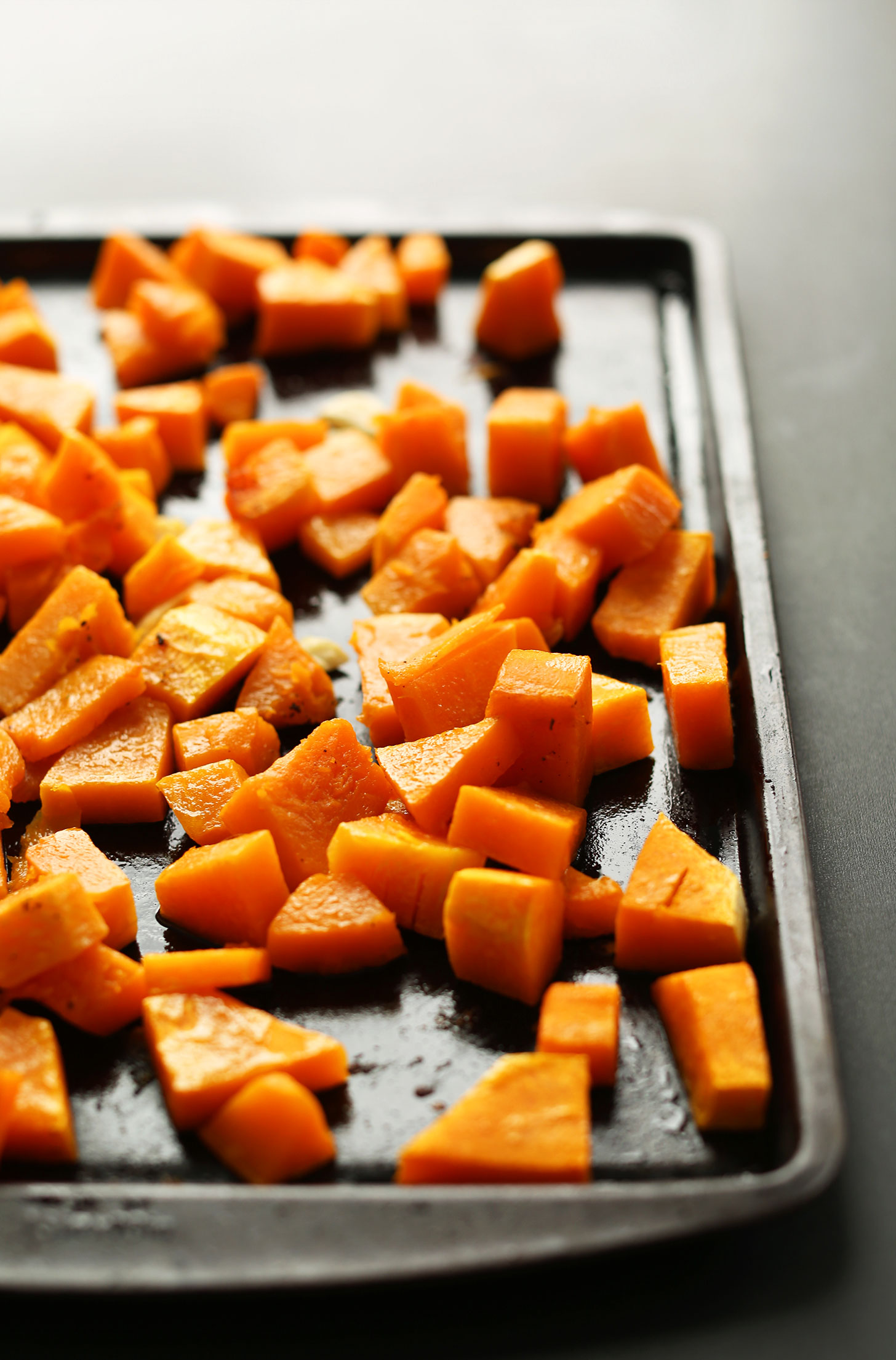 Baking sheet filled with cubes of perfectly roasted butternut squash