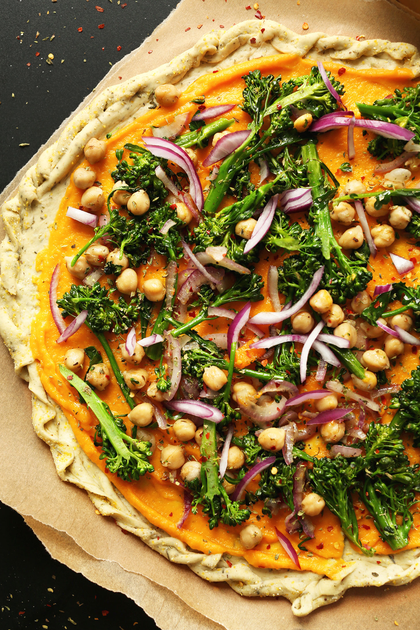 Homemade vegan pizza made with butternut squash sauce and lots of vegetables
