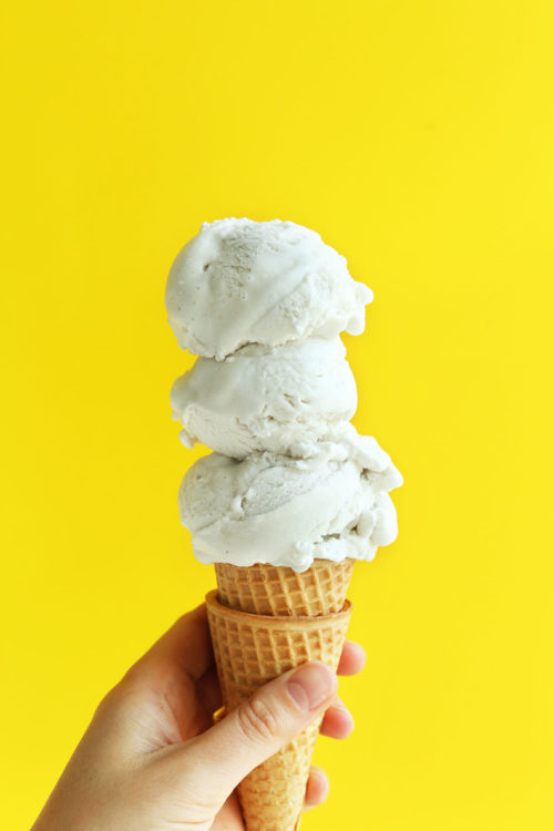 Cone with scoops of coconut vanilla vegan ice cream