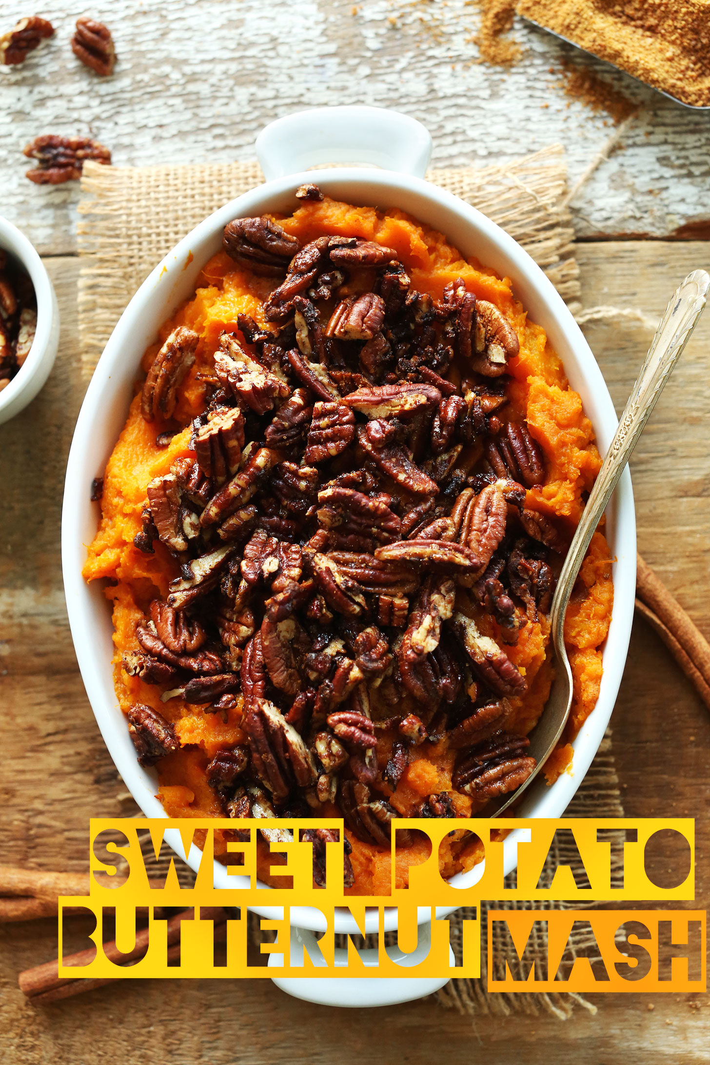 Ceramic baking dish filled with our delicious gluten-free vegan side dish of Butternut Squash Sweet Potato Mash with Maple Cinnamon Pecans