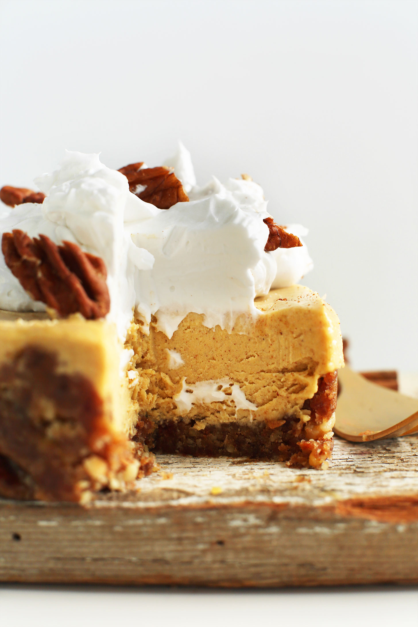 Close up shot showing the creamy texture of our Vegan Pumpkin Cheesecake recipe