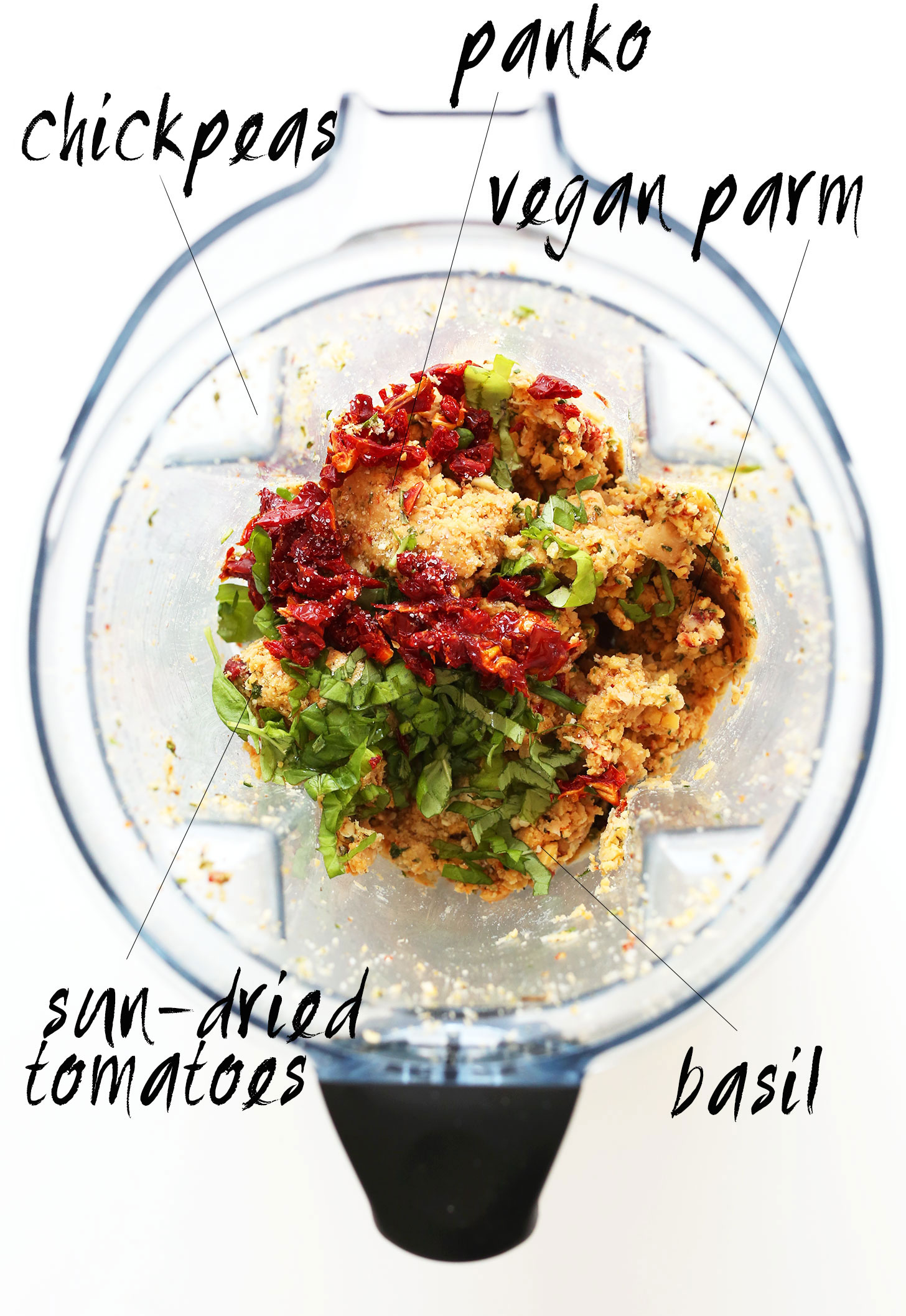 Blender with panko, chickpeas, vegan parmesan, basil, and sun-dried tomatoes for making vegan meatballs
