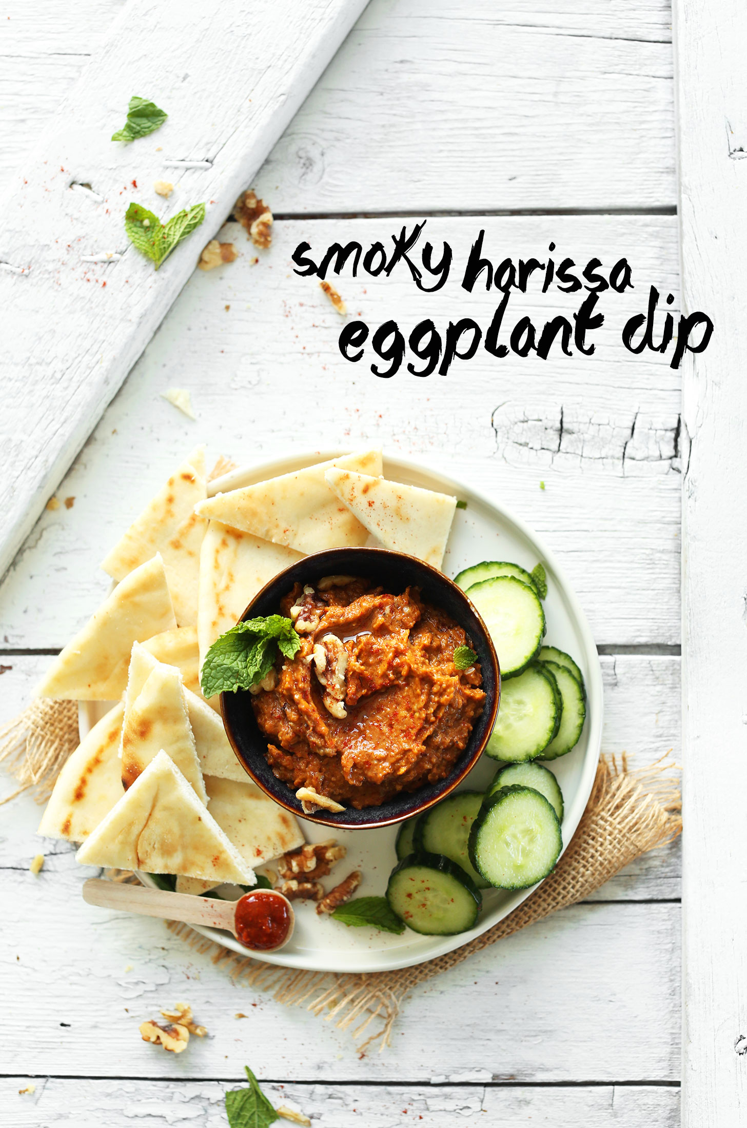 Bowl of our Smoky Eggplant Dip alongside goodies for dipping for the perfect vegan appetizer