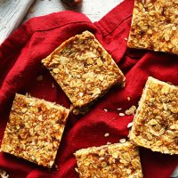 Homemade crunchy PB Granola Bars on a red linen