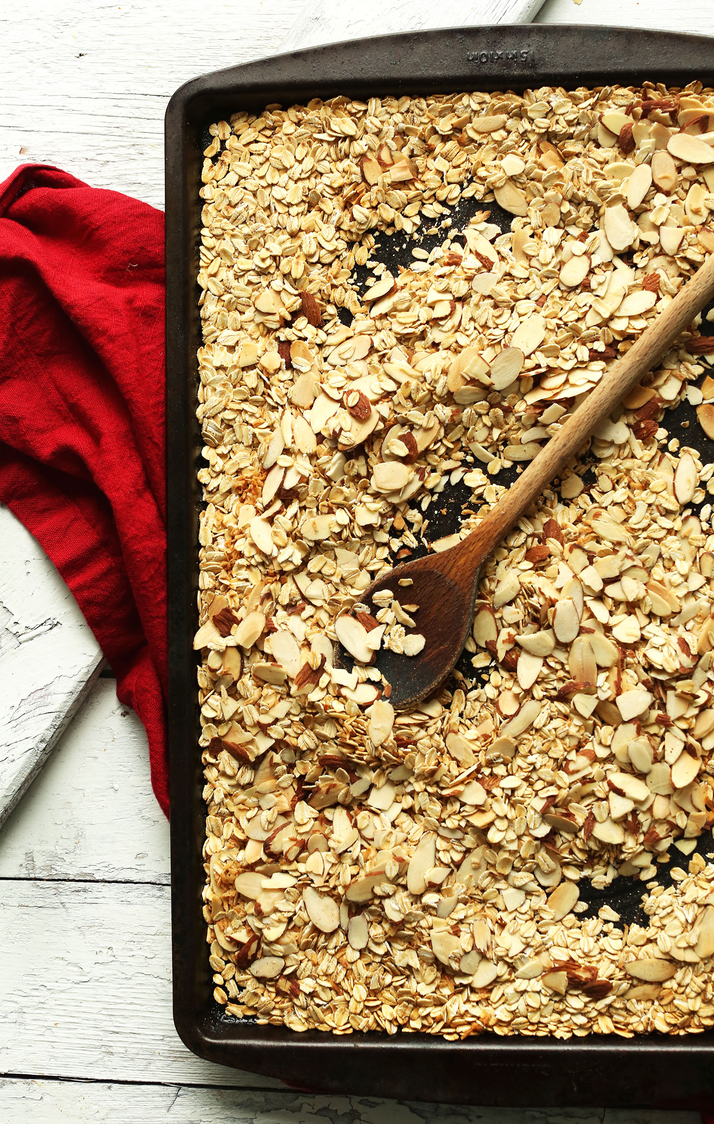 Baking sheet with oats and almonds for making our Easy homemade Peanut Butter Granola Bars