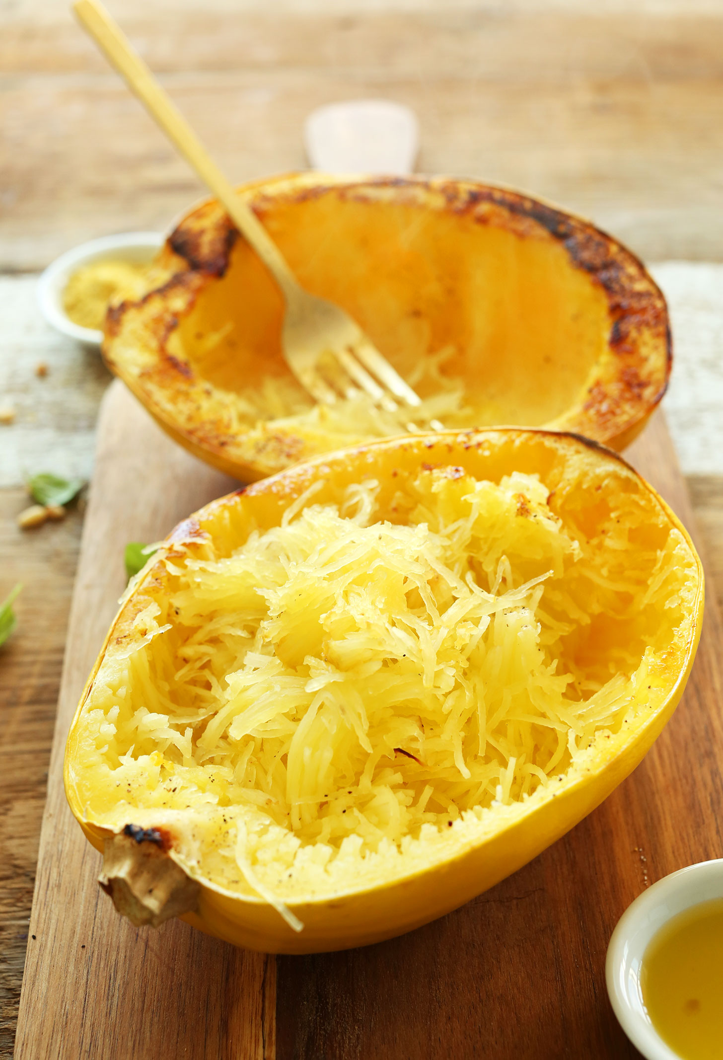 Freshly baked spaghetti squash prepared into strands for making an easy gluten-free vegan dinner