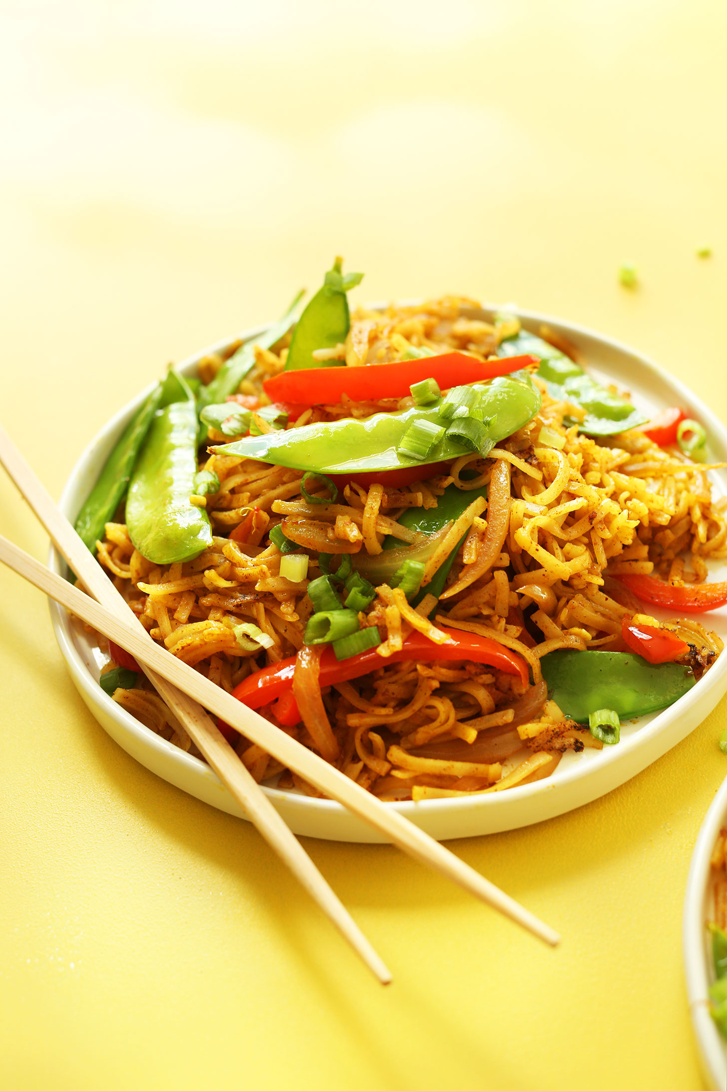 Plate of our Singapore Noodles recipe for a simple gluten-free vegan dinner