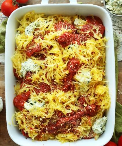 Ceramic baking dish filled with a healthy vegan fall recipe of Spaghetti Squash Lasagna Bake