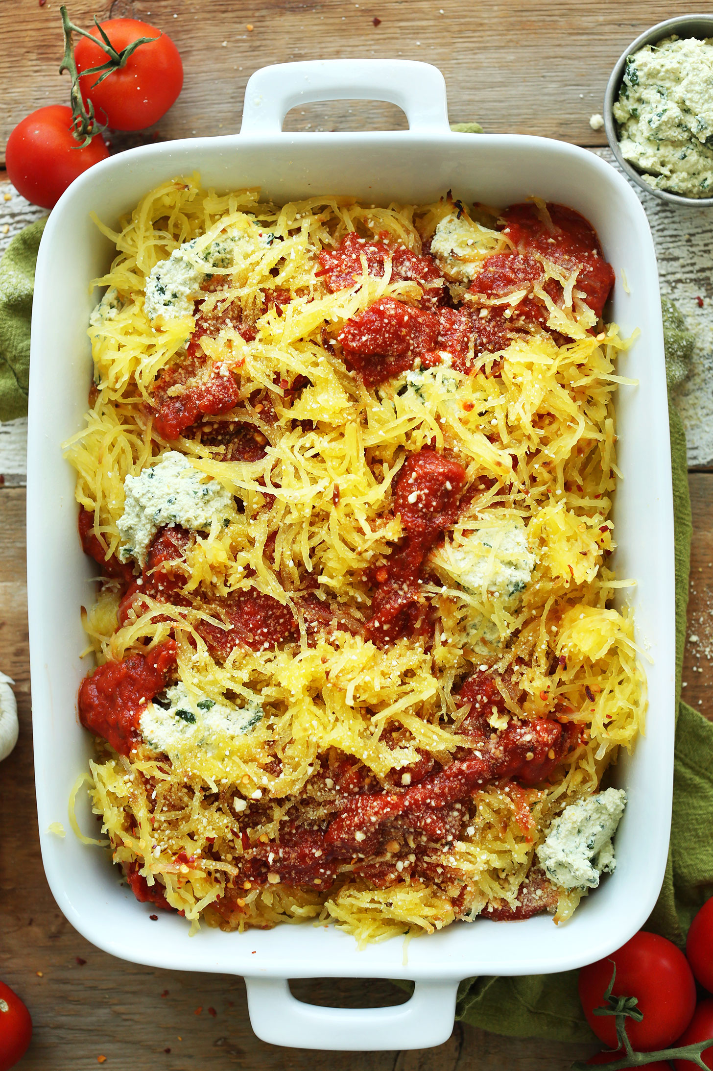 Ceramic baking dish filled with a healthy vegan fall recipe of Spaghetti Squash Lasagna Bake