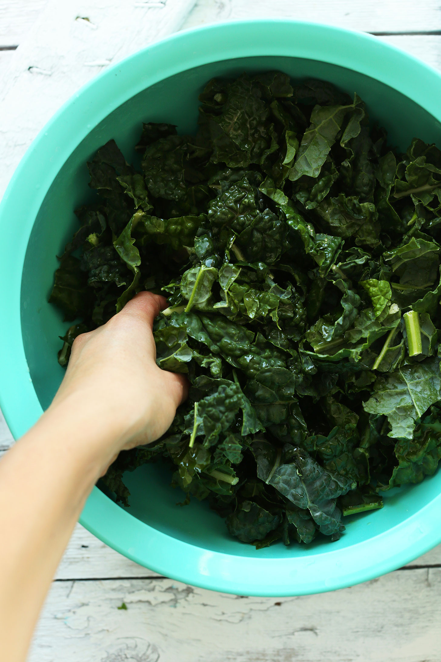 Massaging kale for a delicious vegan whole meal salad recipe