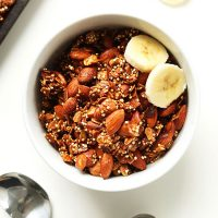 Bowl of Quinoa Granola with two slices of banana