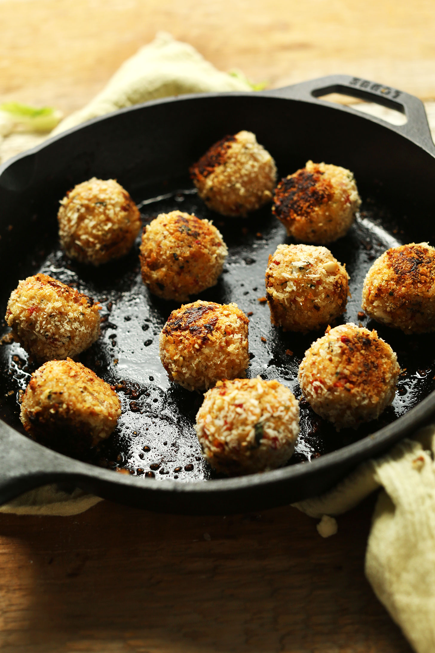 Cooking homemade Vegan Arancini in a cast-iron skillet