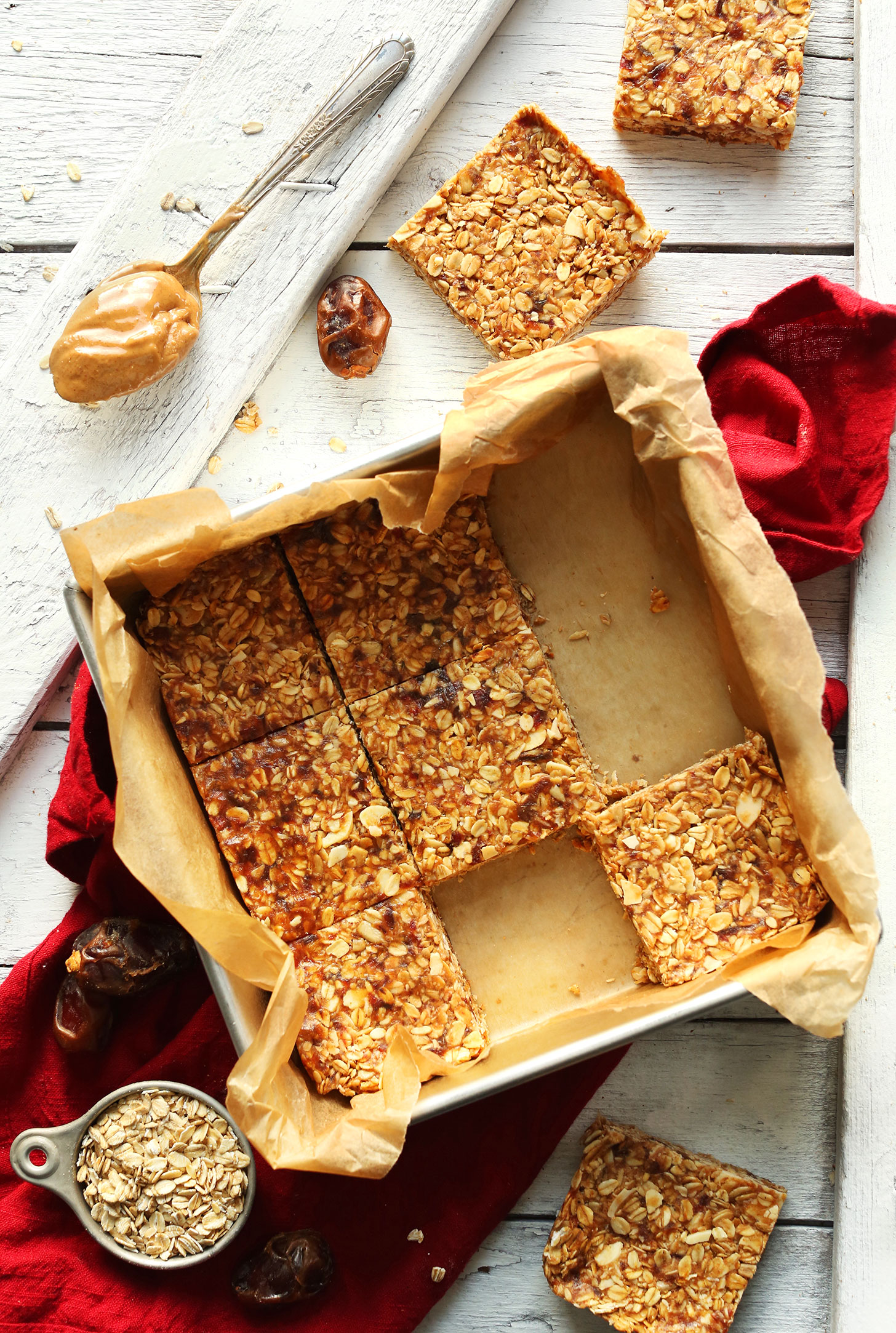 Parchment-lined baking pan with our gluten-free vegan Peanut Butter Granola Bars