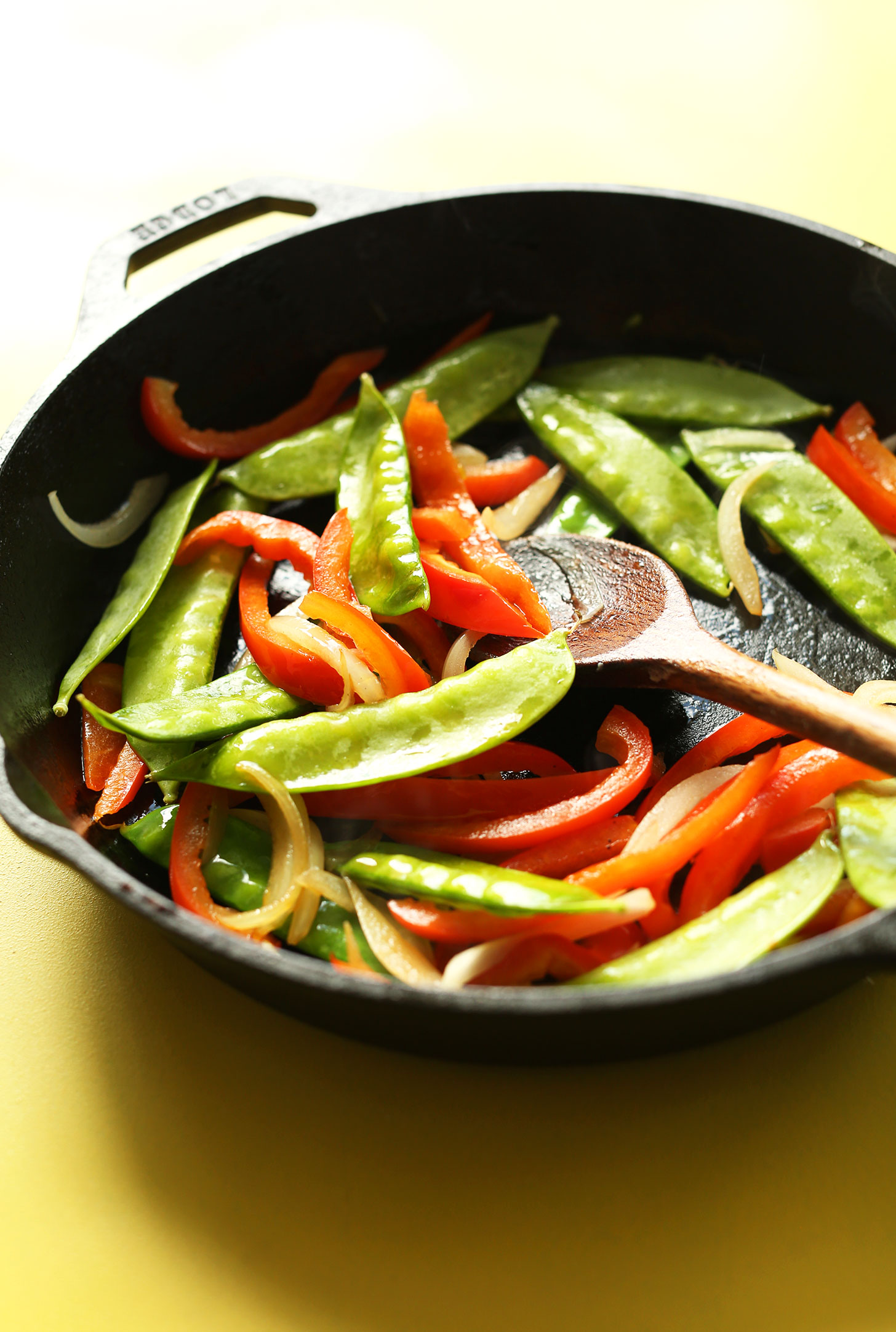 Sautéing vegetables in a cast-iron skillet for our Vegan Singapore Noodles recipe