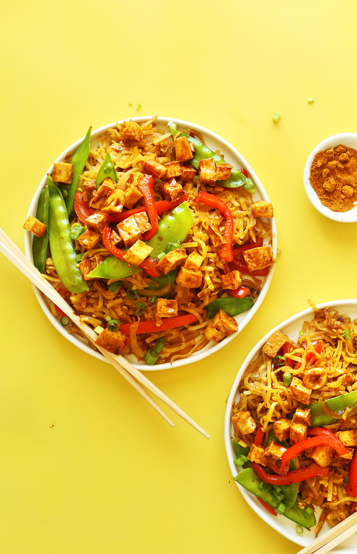 Dinner plates piled high with delicious Vegan Singapore Noodles for a flavorful simple meal