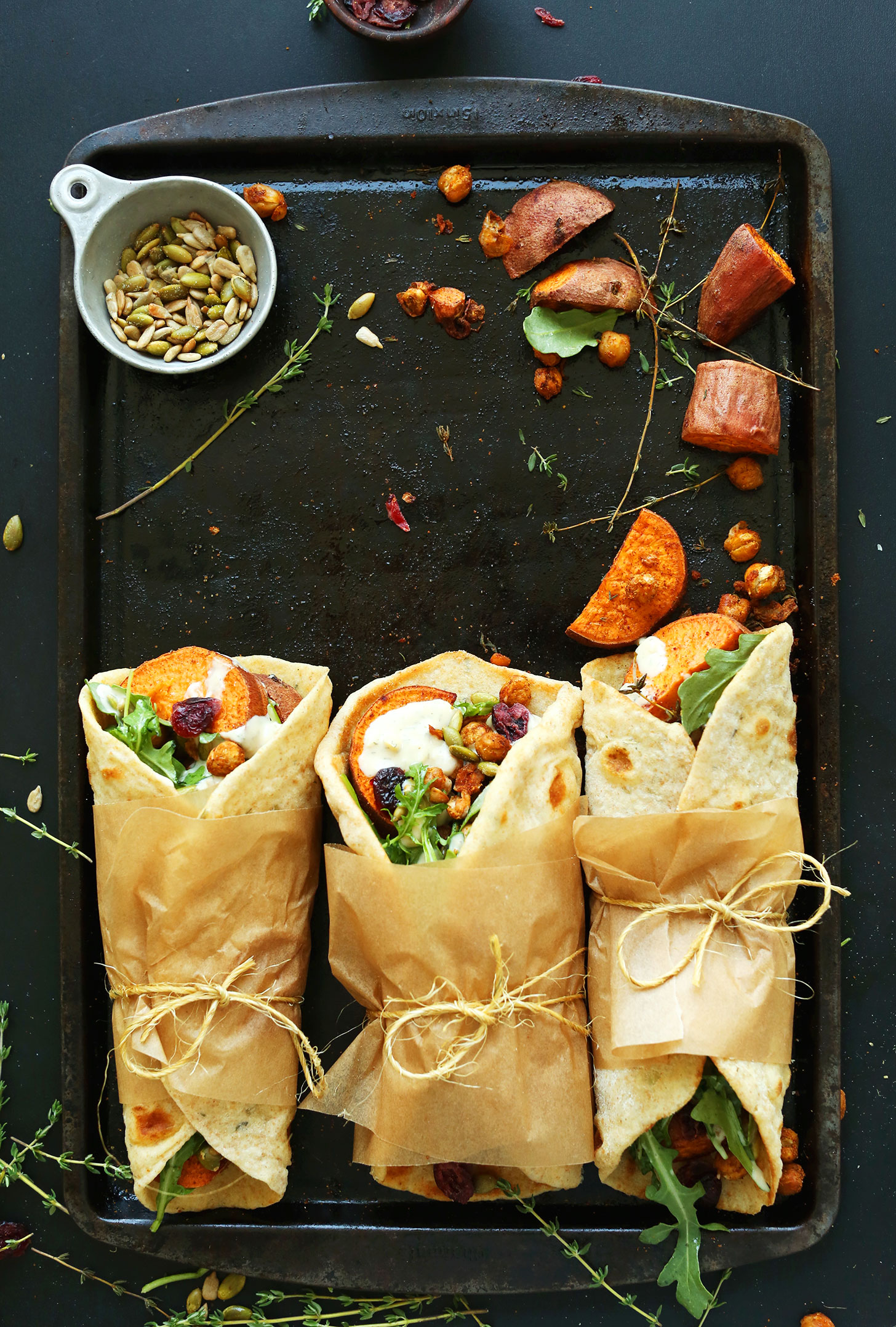 Baking sheet with Fall Bounty Thanksgiving Wraps tied with parchment paper and twine
