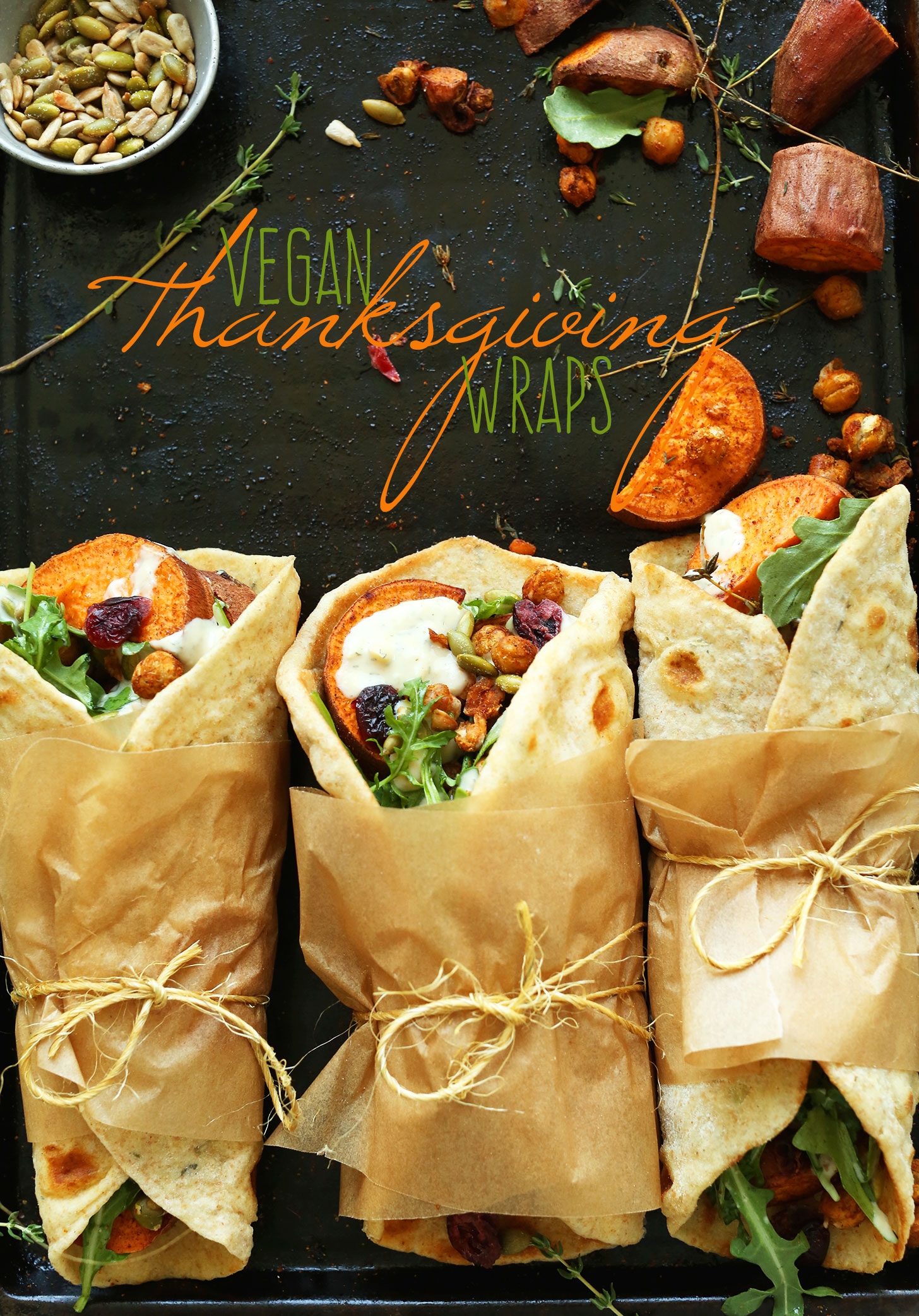 Baking sheet with vegan Thanksgiving Wraps filled with fall goodies